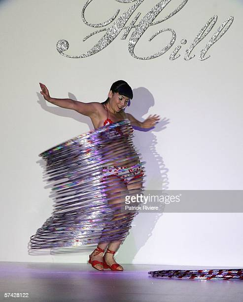 A model hula hoops on the runway at the Alannah Hill collection show in the Overseas Passenger Terminal during Mercedes Australian Fashion Week on...