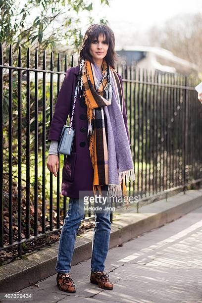 Model Iana Godnia exits the Burberry Prorsum show in Burberry during London Fashion Week Fall/Winter 2015/16 at Kensington Gardens on February 23...