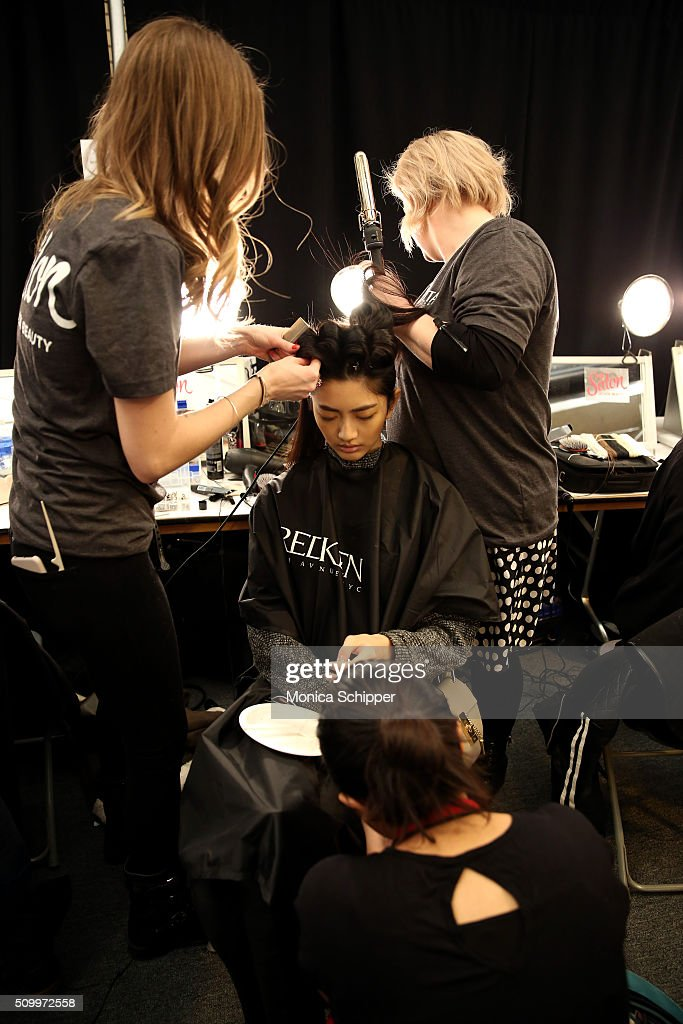 Model I-Hua Wu prepares backstage at Taoray Wang fashion show during Fall 2016 New York Fashion Week: The Shows at The Dock, Skylight at Moynihan Station on February 13, 2016 in New York City.