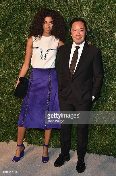 Model Imaan Hammam and designer Derek Lam attend the 11th annual CFDA/Vogue Fashion Fund Awards at Spring Studios on November 3 2014 in New York City