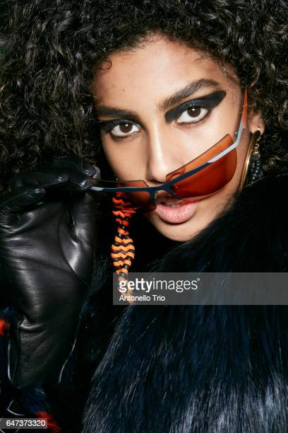 Model Imaan Hammam is seen backstage ahead of the Versace show during Milan Fashion Week Fall/Winter 2017/18 on February 24 2017 in Milan Italy