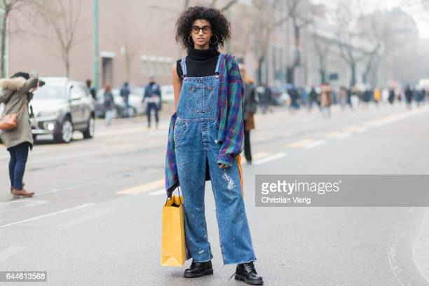 Model Imaan Hammam wearing a denim overall outside Fendi during Milan Fashion Week Fall/Winter 2017/18 on February 23 2017 in Milan Italy
