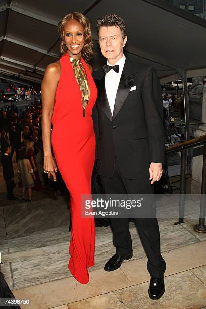 Model Iman and musician David Bowie pose inside during the 25th Anniversary of the Annual CFDA Fashion Awards held at the New York Public Library...