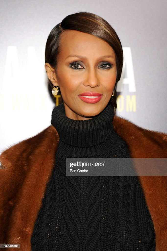 Model <a gi-track='captionPersonalityLinkClicked' href=/galleries/search?phrase=Iman+-+Fashion+Model&family=editorial&specificpeople=132463 ng-click='$event.stopPropagation()'>Iman</a> attends the screening of 'Mandela: Long Walk to Freedom', hosted by U2, Anna Wintour and Bob & Harvey Weinstein, with Burberry at the Ziegfeld Theater on November 25, 2013 in New York City.