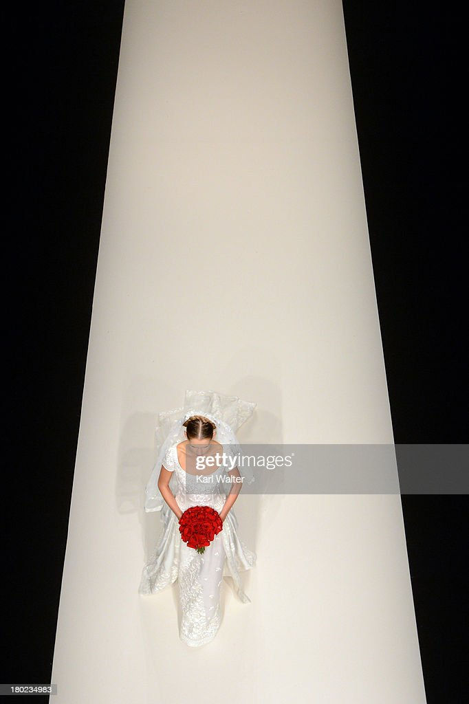 A model in a bridal gown walks the Naeem Kahn runway during Mercedes-Benz Fashion Week Spring 2014 at Lincoln Center for the Performing Arts on September 10, 2013 in New York City.
