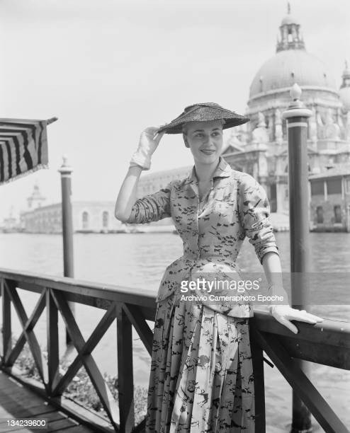 A model in a Christian Dior outfit with the Basilica of Santa Maria della Salute in the background Venice 3rd June 1951