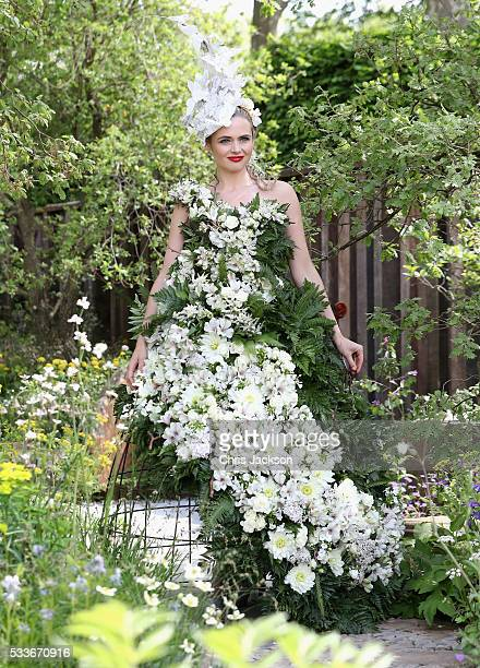 A model in a dress made of flowers at the MG Investments Garden at RHS Chelsea Flower Show on May 23 2016 in London England