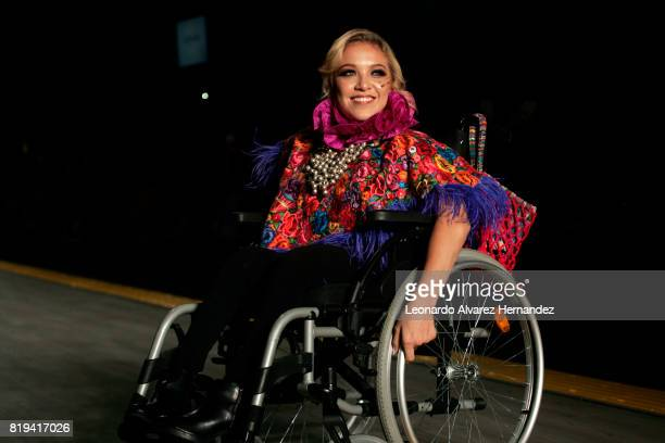 A model in a wheelchair looks on during Guatemalan fashion designer Isabella Springmühl show as part of IM Intermoda 2017 at Expo Guadalajara on July...