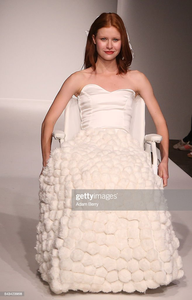 A model in a wheelchair on the runway at the Green Showroom show during the Mercedes-Benz Fashion Week Berlin Spring/Summer 2017 at Postbahnhof on June 28, 2016 in Berlin, Germany.