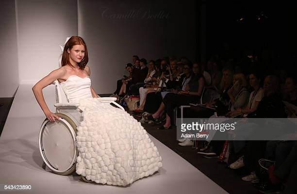 A model in a wheelchair poses on the runway at the Green Showroom show during the MercedesBenz Fashion Week Berlin Spring/Summer 2017 at Postbahnhof...