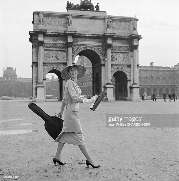 Model in front of the Arc de Triomphe du Carrousel near the Louvre museum and the Tuilleries garden 1960 in Paris France