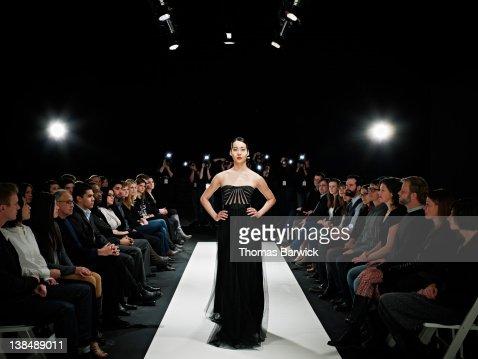 Model in gown walking down catwalk