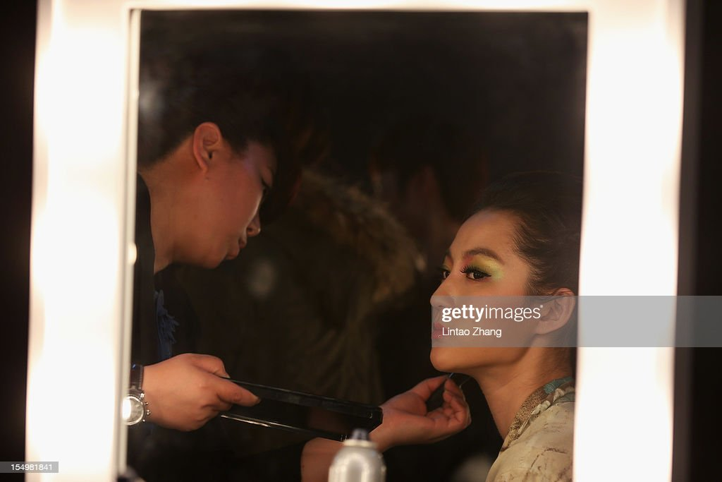 A model in make-up before the ESMOD Graduate collection show of the China Fashion Week S/S Collection 2013 at Beijing Hotel on October 29, 2012 in Beijing, China.