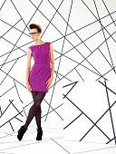 Model in purple dress in studio