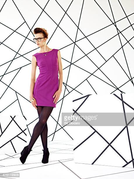 Model in purple dress in studio