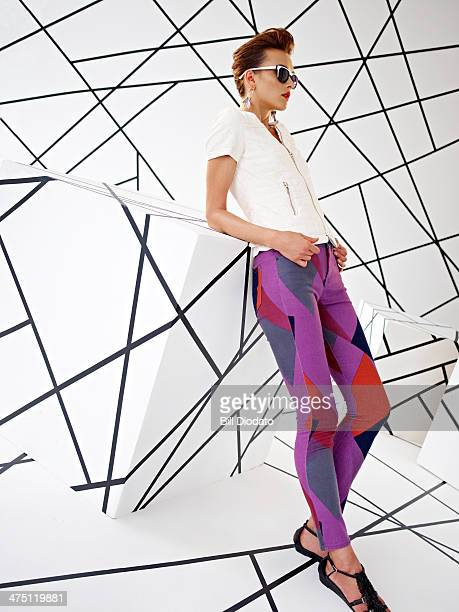 Model in studio with colorful pants