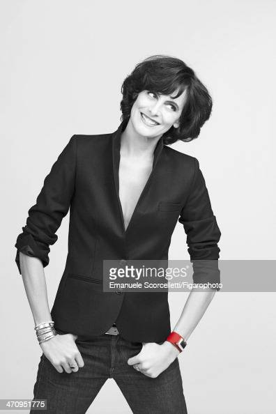 108609008 Model Ines de la Fressange is photographed for Madame Figaro on January 8 2014 in Paris France Jacket cuffs belt jeans and jewelry personal...