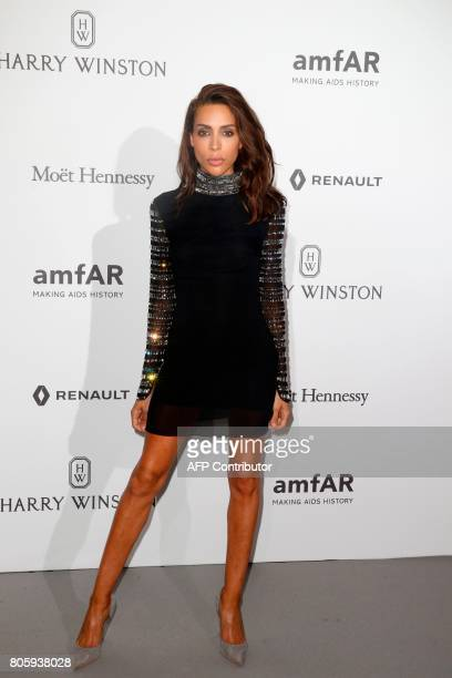 Model Ines Rau poses during a photocall as part of a dinner organized by the foundation for AIDS research amfAR on July 2 2017 at the Grand Palais in...