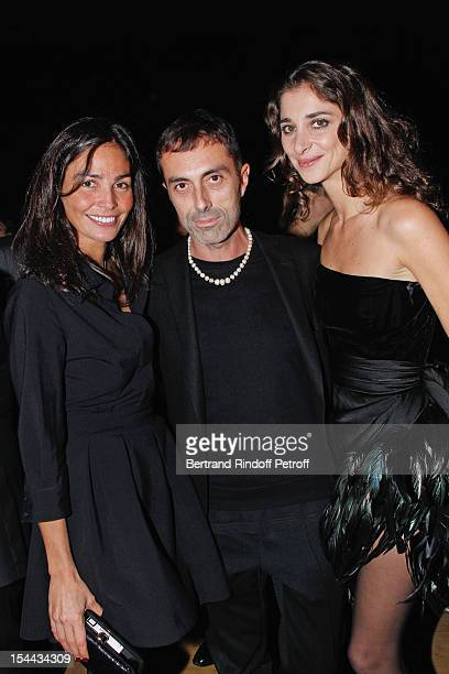 Model Ines Sastre fashion designer Giambattista Valli and Lorraine Ricard attend 'Bal Jaune 2012' organized by the Ricard Corporate Foundation for...