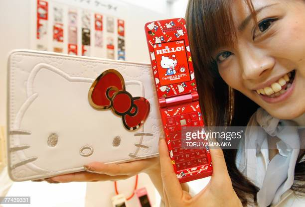 A model introduces Japan's mobile carrier Softbank Mobile's new 'Hello Kitty' handset and attached jewelery box during a press conference in Tokyo 22...