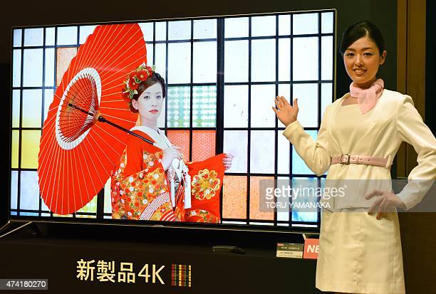 A model introduces the new 80 inch 4K LCD TV 'Aquos 4K Next' of Japan's electronics giant Sharp during a press conference in Tokyo on May 21 2015...