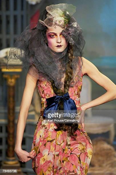 Model Irina Lazareanu walks the catwalk during the John Galliano fashion show as part of Paris Fashion Week Autumn/Winter 2008 on March 3 2007 in...