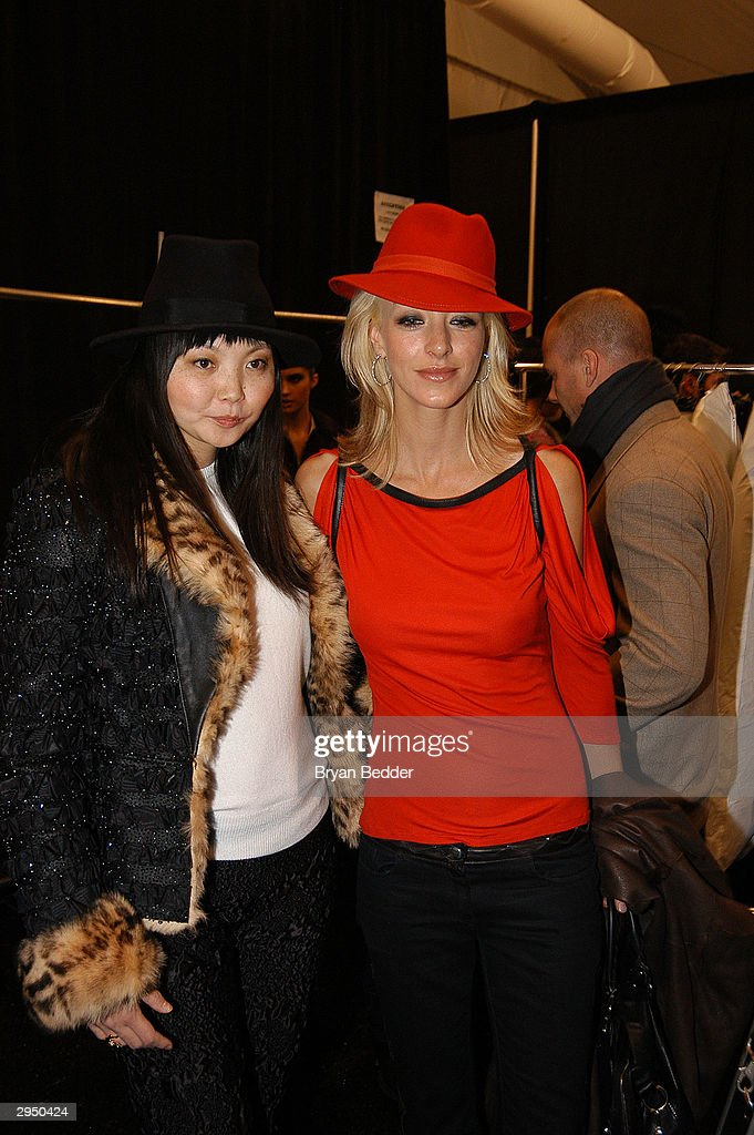 Model Irina Pantaeva (L) poses backstage at the Luca Luca fashion show at Bryant Park during the Olympus 2004 Fall Fashion Show February 8, 2004 in New York City.