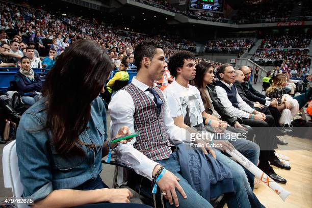 Model Irina Sahyk and Real Madrid football players Cristiano Ronaldo and Pepe look on during the 20132014 Turkish Airlines Euroleague Top 16 Date 11...