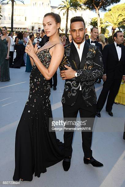 Model Irina Shayk and driver Lewis Hamilton attend the amfAR's 23rd Cinema Against AIDS Gala at Hotel du CapEdenRoc on May 19 2016 in Cap d'Antibes...