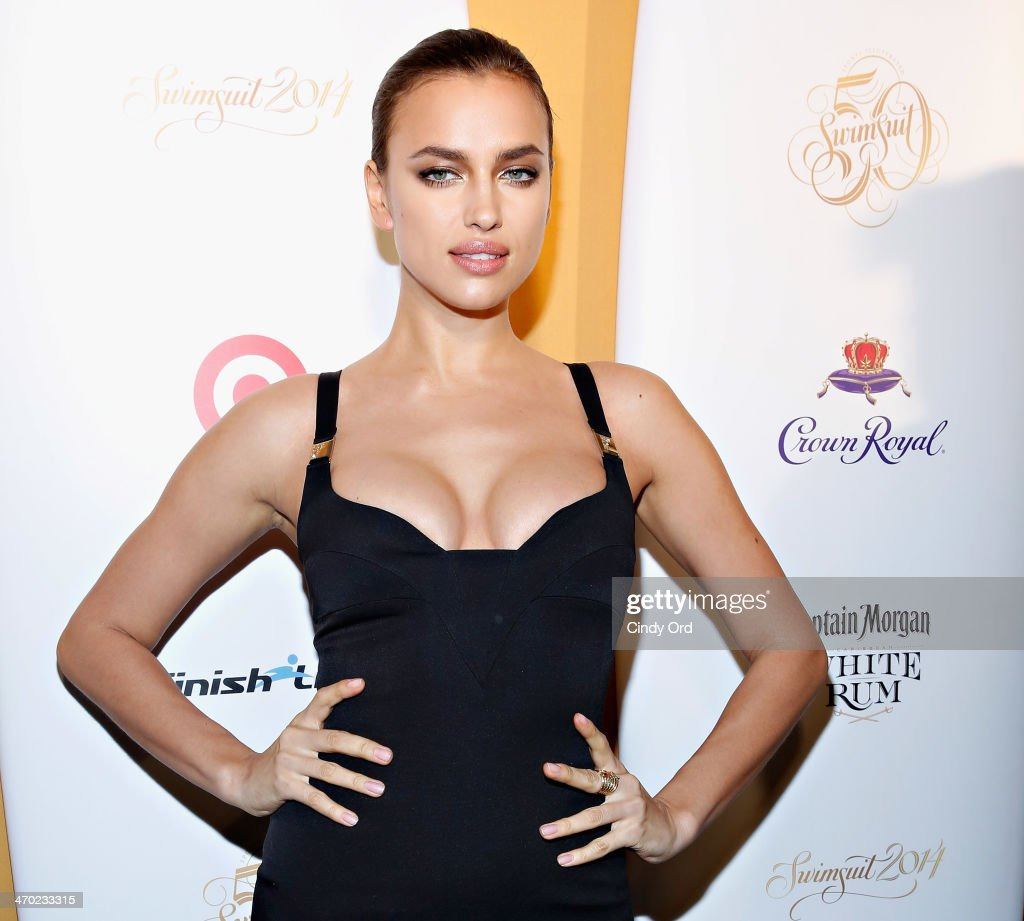 Model Irina Shayk attends as Captain Morgan White Rum and Crown Royal XO raise a glass to the Sports Illustrated Swimsuit 50 Years of Swim Issue at the Sports Illustrated Swimsuit Beach House on February 18, 2014 in New York City.