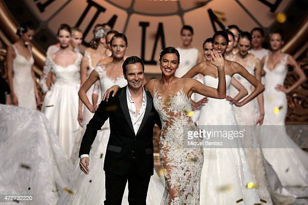 Model Irina Shayk hugs French designer Herve Moreau at the end the runway for the Pronovias fashion show 2016 as part of the Barcelona Bridal Week at...