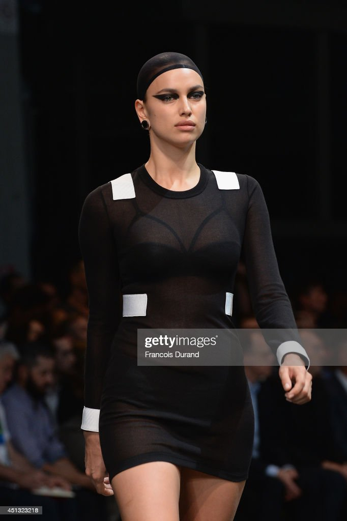 Model Irina Shayk walks the runway during the Givenchy show as part of the Paris Fashion Week Menswear Spring/Summer 2015 on June 27, 2014 in Paris, France.