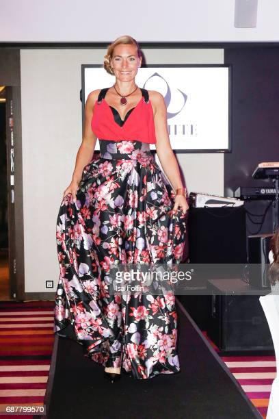 Model Iris Aschenbrenner walks the runway during the Kempinski Fashion Dinner on May 23 2017 in Munich Germany