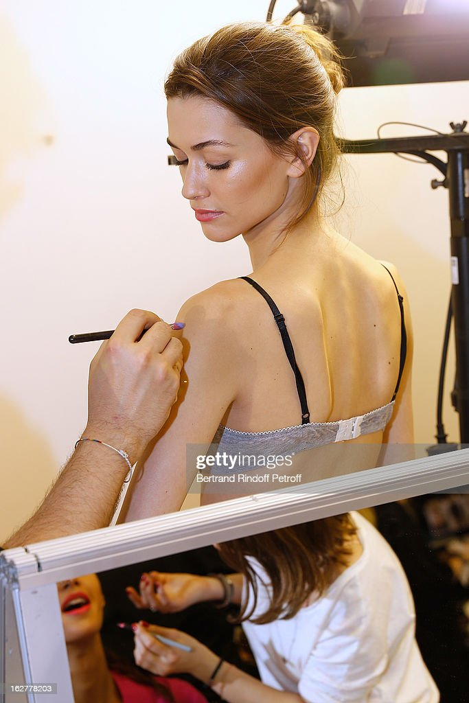 A model is being made up backstage prior to the Etam Live Show Lingerie at Bourse du Commerce on February 26, 2013 in Paris, France.