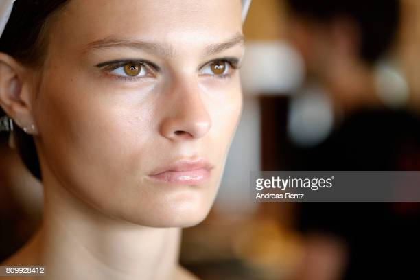 A model is being prepared prior to the Hugo Boss presentation during 'Der Berliner Mode Salon' Spring/Summer 2018 at St Agnes Church on July 6 2017...