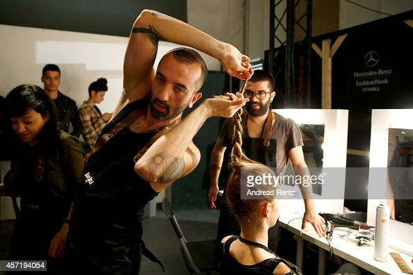 A model is being styled backstage prior the Red Beard By Tanju Babacan show during Mercedes Benz Fashion Week Istanbul SS15 at Antrepo 3 on October...