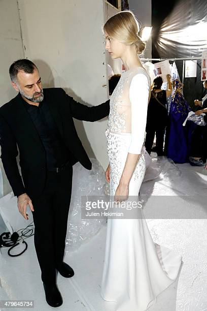 A model is being styled by designer George Hobeika backstage prior the George Hobeika show as part of Paris Fashion Week Haute Couture Fall/Winter...