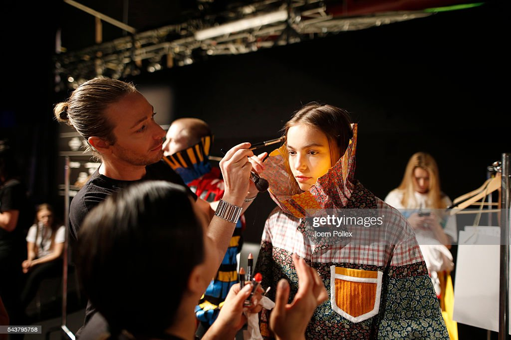 A model is getting her hair done backstage ahead of the Dimitri show during the Mercedes-Benz Fashion Week Berlin Spring/Summer 2017 at Erika Hess Eisstadion on June 30, 2016 in Berlin, Germany.