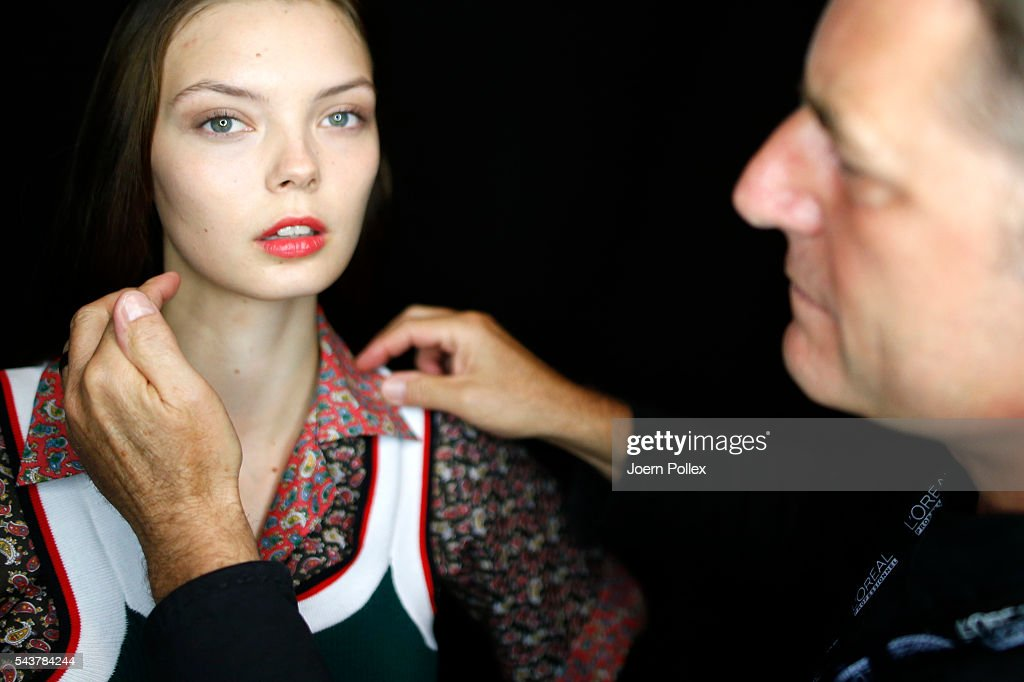 A model is getting her hair done backstage ahead of the Wataru Tominaga presented by Mercedes-Benz & Elle show during the Mercedes-Benz Fashion Week Berlin Spring/Summer 2017 at Erika Hess Eisstadion on June 30, 2016 in Berlin, Germany.