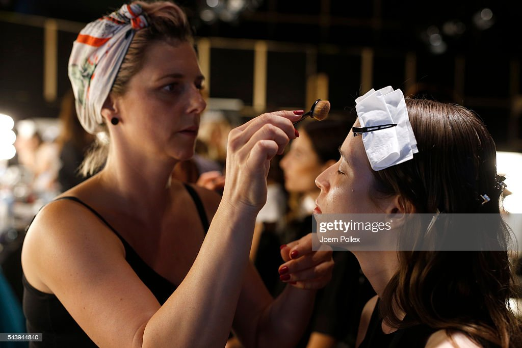 A model is getting her make up done backstage ahead of the Maisonnoee show during the Mercedes-Benz Fashion Week Berlin Spring/Summer 2017 at Erika Hess Eisstadion on June 30, 2016 in Berlin, Germany.