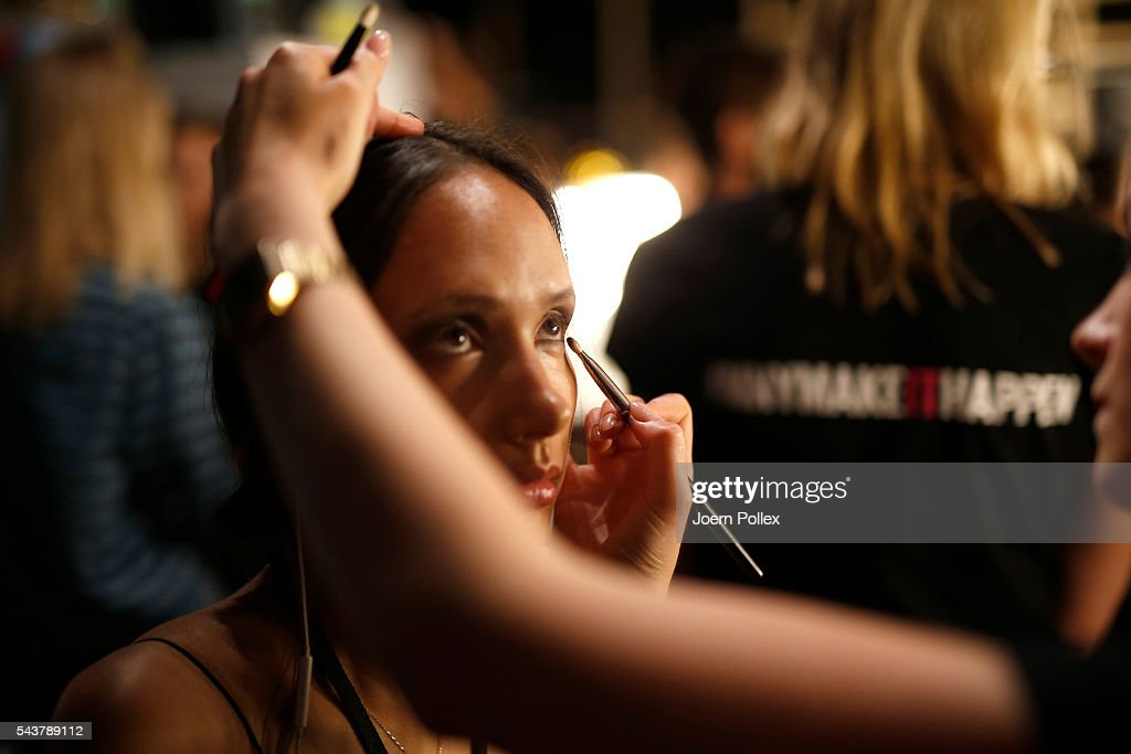 A model is getting her Make up done backstage ahead of the Wataru Tominaga presented by Mercedes-Benz & Elle show during the Mercedes-Benz Fashion Week Berlin Spring/Summer 2017 at Erika Hess Eisstadion on June 30, 2016 in Berlin, Germany.