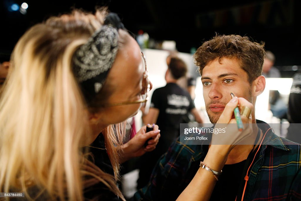 A model is getting his Make Up done backstage ahead of the Wataru Tominaga presented by Mercedes-Benz & Elle show during the Mercedes-Benz Fashion Week Berlin Spring/Summer 2017 at Erika Hess Eisstadion on June 30, 2016 in Berlin, Germany.