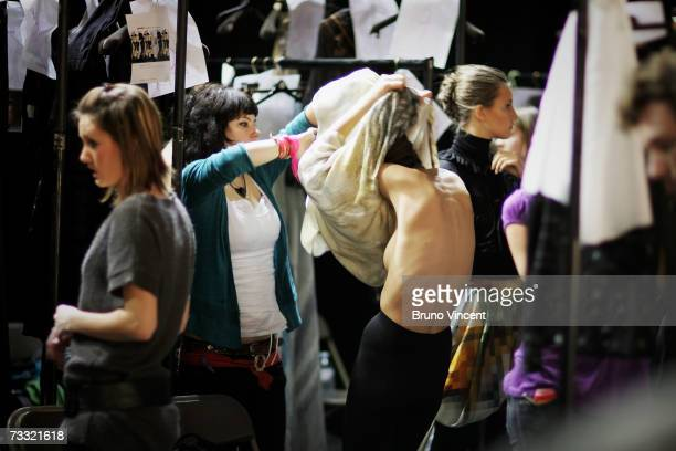 A model is helped into her garment during Basso Brooke's Autumn/winter show at London Fashion Week on February 14 2007 in London Designers promote...