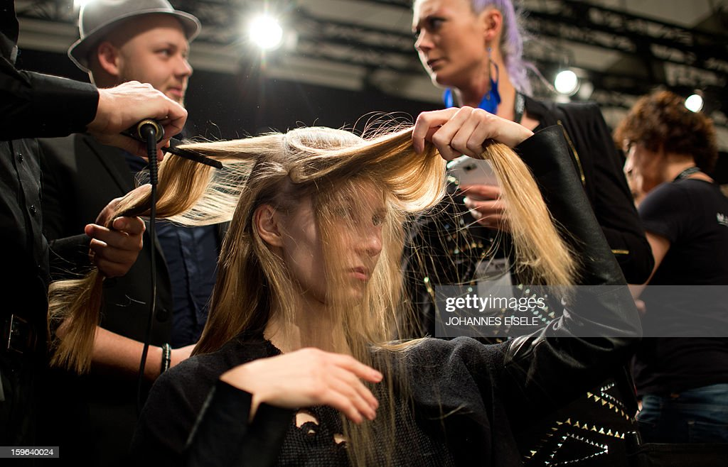 A model is pictured back stage to present a creation by designer 'Michael Sonntag' during the Autumn/Winter 2013 shows of the Mercedes-Benz Fashion Week on January 17, 2013 in Berlin. The Berlin Fashion Week takes place from January 15 to 20, 2013.