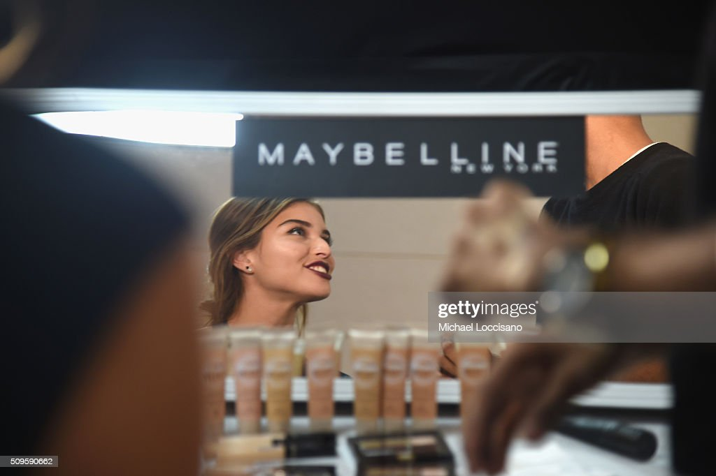 A model is prepared at the Maybelline display at Fall 2016 New York Fashion Week at the Skylight at Clarkson sq on February 11, 2016 in New York City.