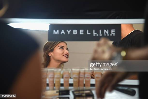 A model is prepared at the Maybelline display at Fall 2016 New York Fashion Week at the Skylight at Clarkson sq on February 11 2016 in New York City