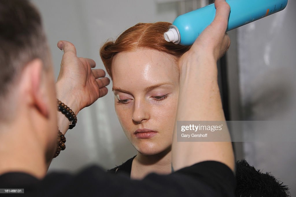 A model is prepared backstage at the Carolina Herrera fashion show during Fall 2013 Mercedes-Benz Fashion Week at The Theatre at Lincoln Center on February 11, 2013 in New York City.