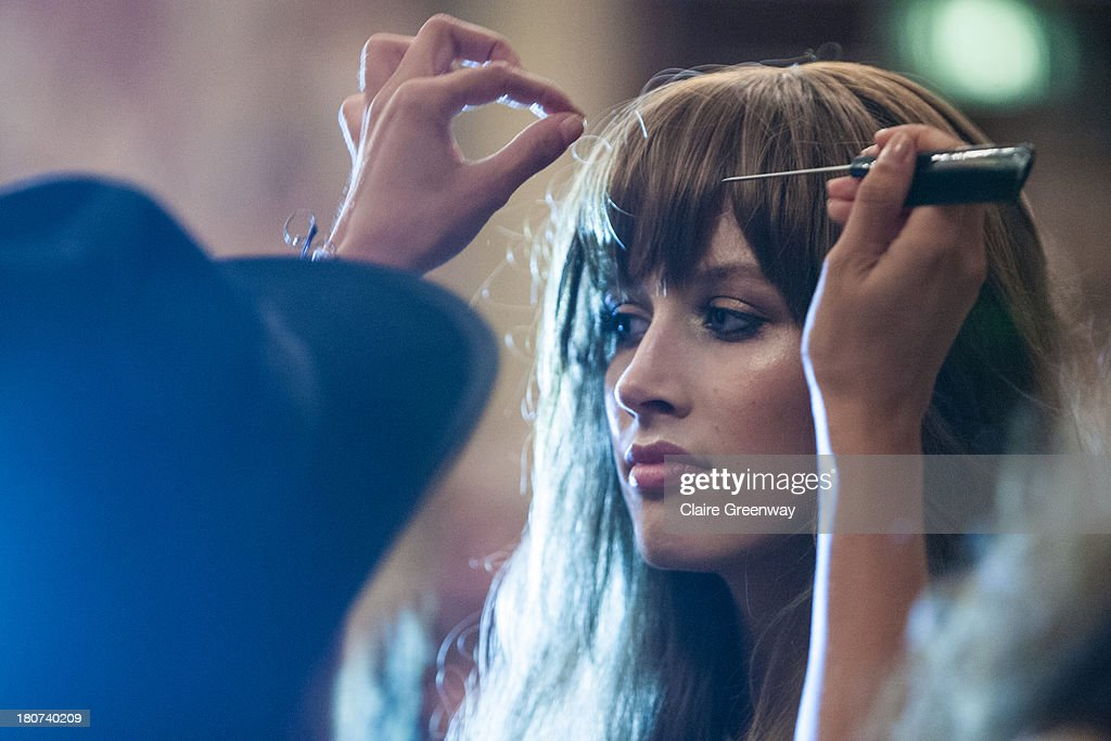 A model is prepared backstage at the Kristian Aadnevik show during London Fashion Week SS14 at The Royal Horseguards on September 15, 2013 in London, England.