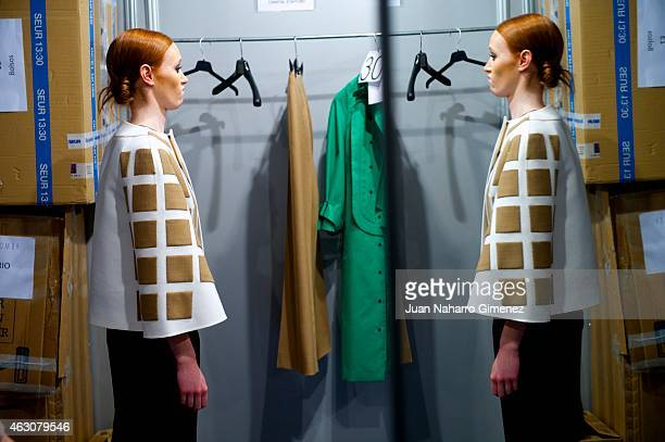 A model is seen at the backstage before Doveta Lomba fashion show during Mercedes Benz Madrid Fashion Week Fall/Winter 2015/2016 at Ifema on February...