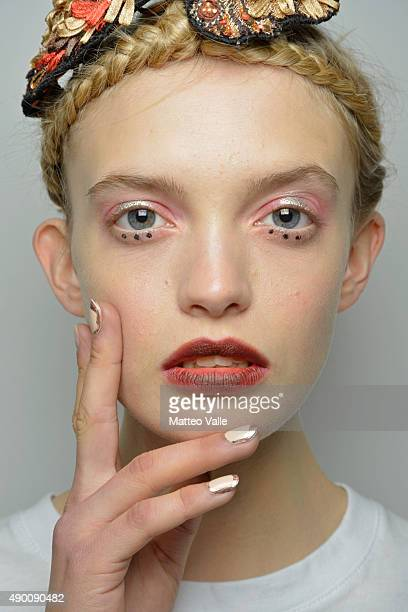 A model is seen backstage ahead of the Antonio Marras show during Milan Fashion Week Spring/Summer 2016 on September 26 2015 in Milan Italy